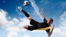 Football Player in Action HD Wallpaper